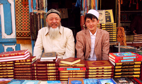 Koran sellers in Kashgar market. Xinjiang, China.