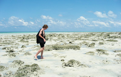 Adam walking on beach after scuba diving Havelock Andaman Islands India