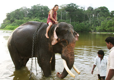 Tina riding Rajan the Elephant Havelock Andaman Islands India
